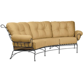 Pictured is the Terrace Crescent Sofa from Woodard Outdoor Furniture, sold by Timeless Wrought Iron.