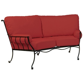 Pictured is the Maddox Crescent Loveseat from Woodard Outdoor Furniture, sold by Timeless Wrought Iron.