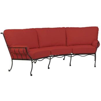 Pictured is the Maddox Crescent Sofa from Woodard Outdoor Furniture, sold by Timeless Wrought Iron.