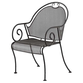 Pictured is the Cantebury Barrel Dining Chair from Woodard Outdoor Furniture, sold by Timeless Wrought Iron.
