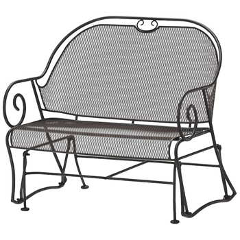 Pictured is the Cantebury Gliding Barrel Loveseat from Woodard Outdoor Furniture, sold by Timeless Wrought Iron.