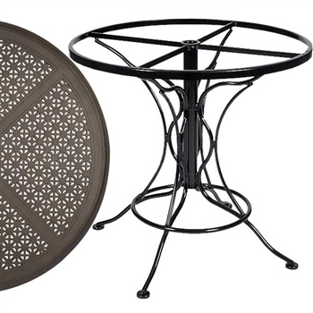Pictured is the Universal Round Dining Table with Hampton Top from Woodard Outdoor Furniture, sold by Timeless Wrought Iron.