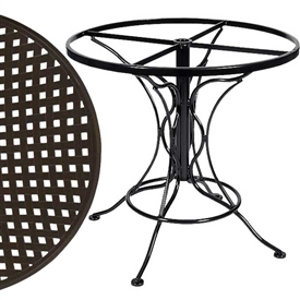 Pictured is the Universal Round Dining Table with Thatch Top from Woodard Outdoor Furniture, sold by Timeless Wrought Iron.