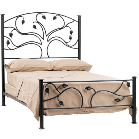 Pictured here is the Live Oak Wrought Iron Bed with hand-forged leaf accents.