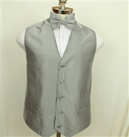 Solid tone on tone with fine specs pattern vest and bowtie