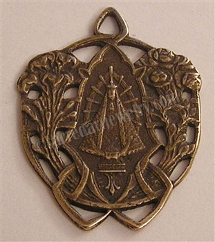 "Our Lady of Lujan Etched Medal 1 1/4"" - Catholic religious medals in authentic antique and vintage styles with amazing detail. Large collection of heirloom pieces made by hand in California, US. Available in true bronze and sterling silver."