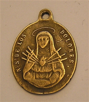 "Our Lady of Sorrows Medal 1 1/8"" - Catholic religious medals in authentic antique and vintage styles with amazing detail. Large collection of heirloom pieces made by hand in California, US. Available in true bronze and sterling silver."