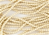 3mm Czech Glass Round Spacer Beads - Opaque Champagne Luster