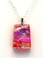 Dichroic glass pendant. Purple, pink and ocean sparkle with rainbow highlights.