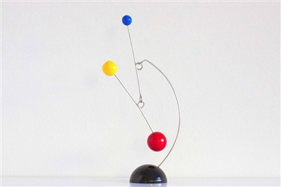 black, yellow, blue and red mid-century modern style hanging mobile