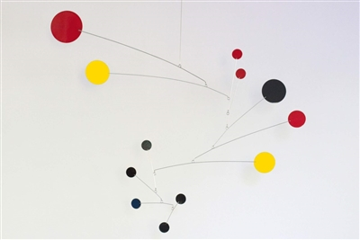 black, yellow and red mid-century modern style hanging mobile