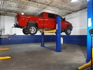 2 Post Truck Lift, 2 Post Car Lift, 15,000 Pound Capacity Truck Lift for lower ceiling installations that offers open overhead section for taller trucks, vans, vehicles with ladder racks. Floorplate car and truck lift for low ceilings or taller vehicles.