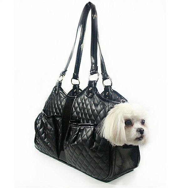 cfa2f763fa A luxurious purse style pet carrier made from soft quilted faux leather  with shiny black trim and silver hardware.