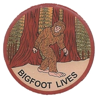 "0475-1218 - BIGFOOT LIVES pin - 1.25"" diameter. Epoxy coated printed pin. Plastic clasp. Individually poly bagged or carded for a retail store display rack (+$.10)."