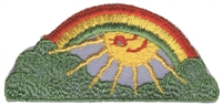 "8205 - rainbow sun embroidered sew on patch. 3.125"" x 1.5"". Patches are carded for a a store display for retail stores. Made in USA."