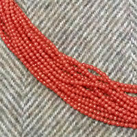 Photo of 2mm Round Coral Beads