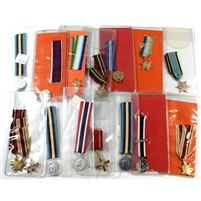 Group Lot of Assorted Mini Metals in Plastic Sleeves with Orange Backgrounds, 16Pcs
