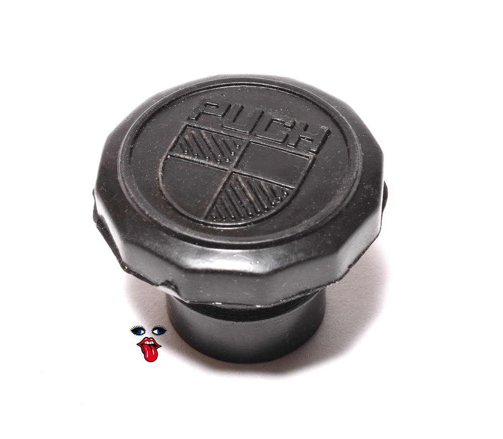 puch maxi N moped black plastic gas cap that says puch on it