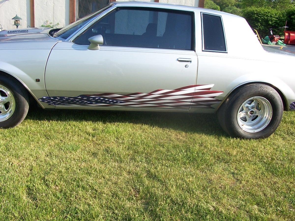 Silver car w american flag race