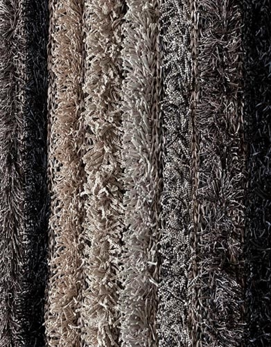 Colors creatively combined by blending different thicknesses of soft yarn, braided ribbon and other textiles, the luxurious Lavasa area rug features an ultra-thick pile that's rich in both texture, tone and design.<br><br>Material: Polyester<br>Dimensions
