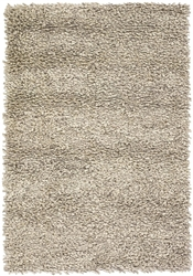 The Betul rug is hand woven in a subtle linear design, giving a contemporary flair to any room.