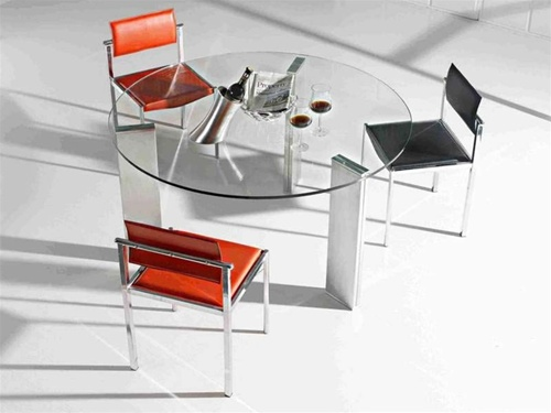 This ultra Modern glass and chrome round Voltera Dining Table is a true work of art