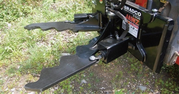 Jawz by Bradco Patented hydraulic grabbing tool, universal skid steer quick attach