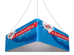 12ft x 36in Blimp Triangle (Trio) Hanging Banners Single Sided has three sides to advertise on and is the largest available. This unit is perfect for Convention Centers, Retail Stores, Trade shows, Malls, or wherever you wish to be noticed.