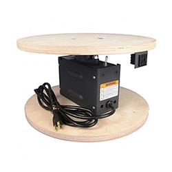 TS-400 Trade Show Rotator designed for easy setup at a tradeshow, this unit is ready to go out of the box.  It comes with an electrical cord for easy plug-in, a switch for changing direction easily, a rotating power outlet, and wooden mounting surfaces