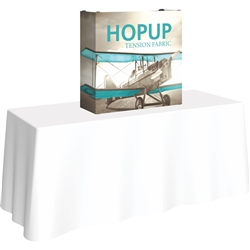 30in x 30in HopUp Straight 1x1 Tabletop Display with Full Fitted Graphic has a light weight, heavy duty frame that holds a fabric graphic mural. Durable stretch fabric graphic stays attached to the HopUp frame for fast and efficient use.