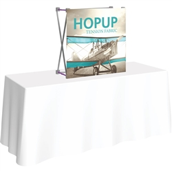 30in x 30in HopUp Straight 1x1 Tabletop Display with Front Graphic has a light weight, heavy duty frame that holds a fabric graphic mural. Durable stretch fabric graphic stays attached to the HopUp frame for fast and efficient use.