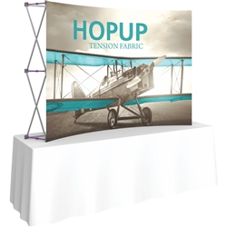8ft Curved HopUp 3x2 Tabletop Fabric Display with Front Graphic is the instant trade show table top solution! Hopup is an all new light weight yet heavy duty frame that suspends a fabric graphic image