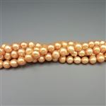 "5mm round peachy-orange fresh water pearls, one 16"" strand"