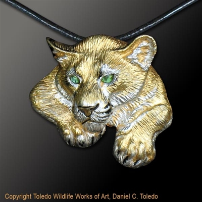 "Cougar Pendant ""Shadow Cat"" by wildlife artist jeweler Daniel C. Toledo, Toledo Wildlife Works of Art.  Rhodium and 22k gold plated over sterling silver, black enamel, peridot eyes.  Limited edition of 250"