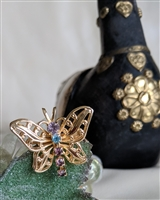 Gold tone butterfly brooch and pendant with beads