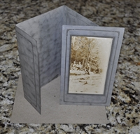 Logging scenery postcard with in a cardboard frame