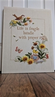 Needlepoint canvas with phrase birds and flowers