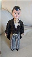 Sleepy eyes groom doll moving hands hard plastic