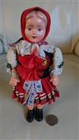 Rubber and hard plastic traditionally dressed doll