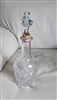 Etched glass decanter embossed sides footed design