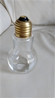 Glass light bulb pepper shaker with metal top