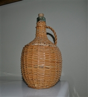 Aqua green wine bottle in wicker basket enclosure