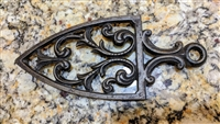 Wilton vintage triangular cast iron trivet