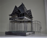 Metal bird cage display in Victorian house style