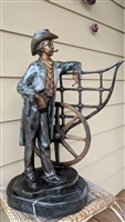 Metal art sculpture Frontier Cowboy resting
