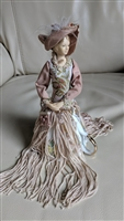 Victorian style porcelain doll with tassle dress