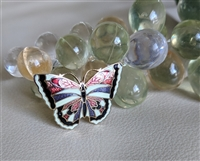 Enamel and gold tone metal trendy butterfly brooch