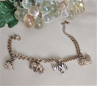 African animals charm bracelet in gold tone metal