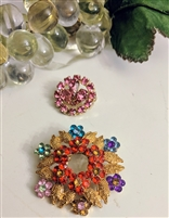 Costume jewelry brooches in floral colorful design