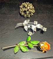 Giovanni enamel rose and two floral brooches set